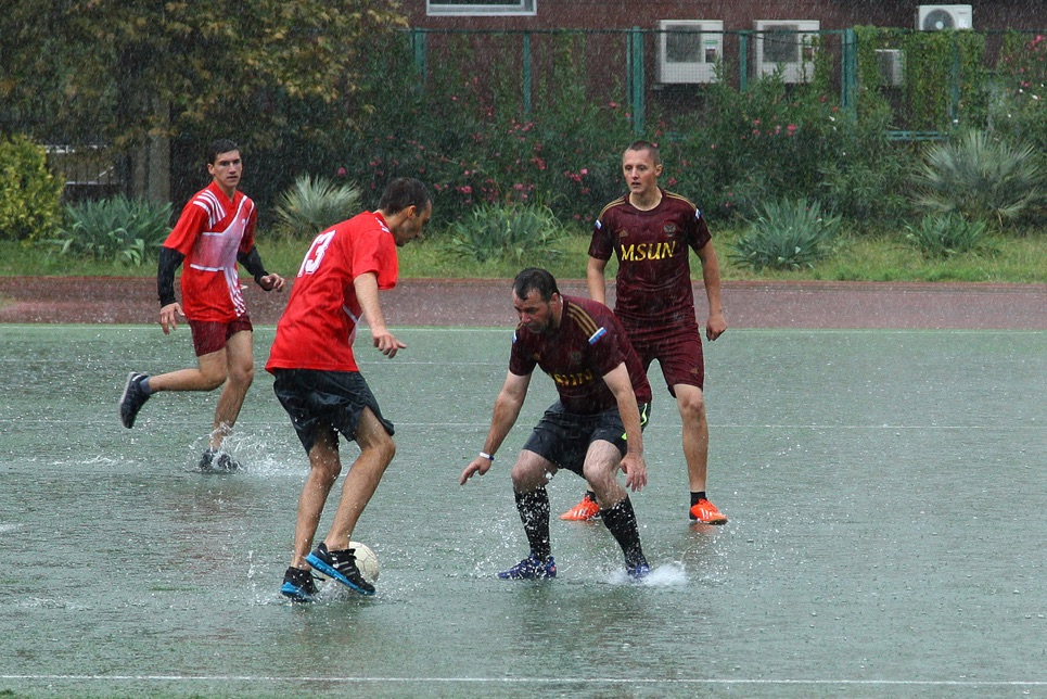 Playing football in the rain