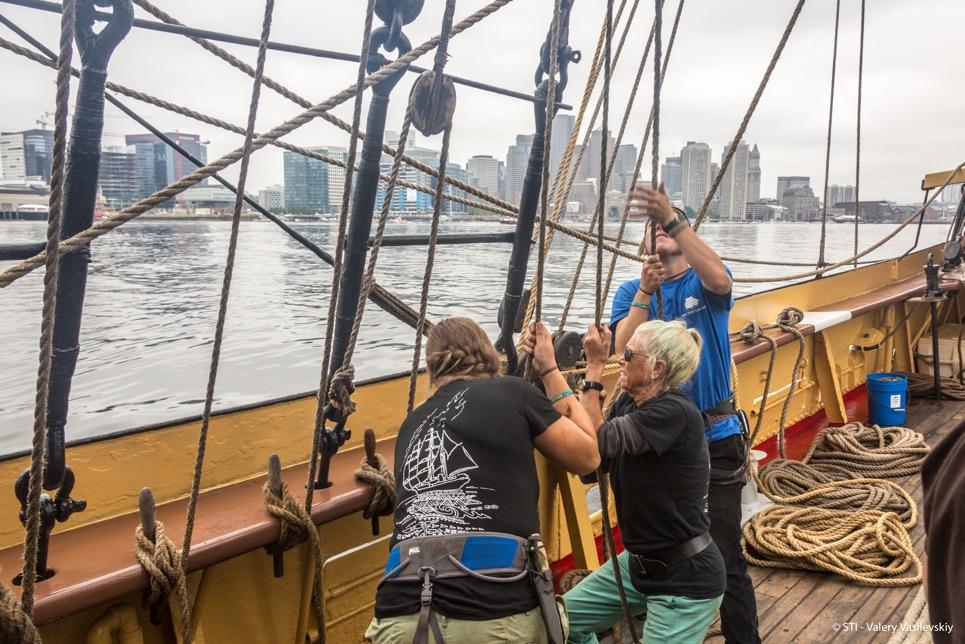 Raising the sails Grand Parade of Sail in Boston.